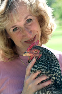 Sy with one of her hens: credit Vicki Stiefel