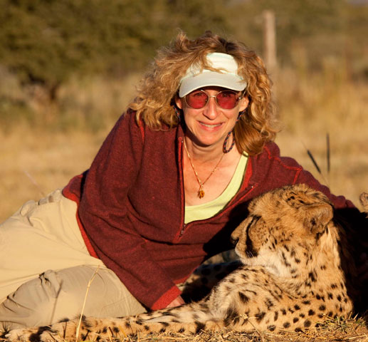 Sy with a cheetah in Namibia: credit Nic Bishop